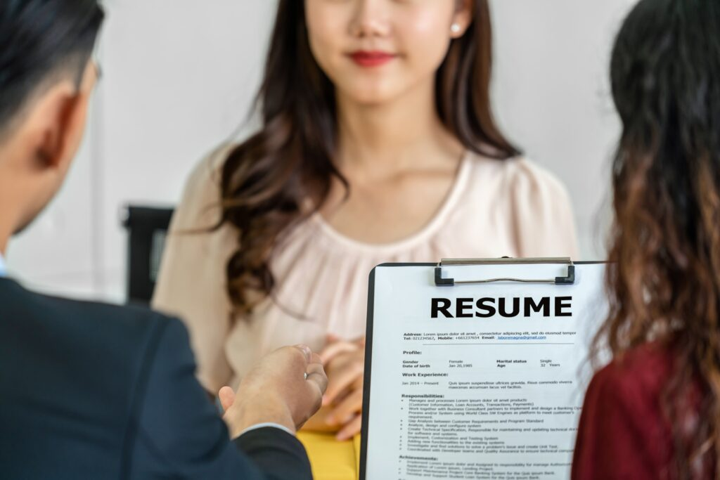 Closeup Resume in two manager hand holding when discuss about her resume